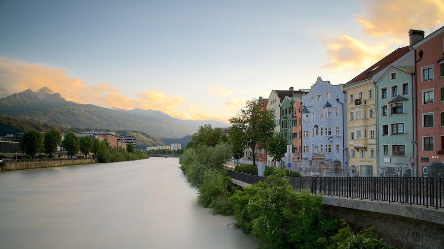 Innsbruck showing heritage elements, a river or creek and a sunset