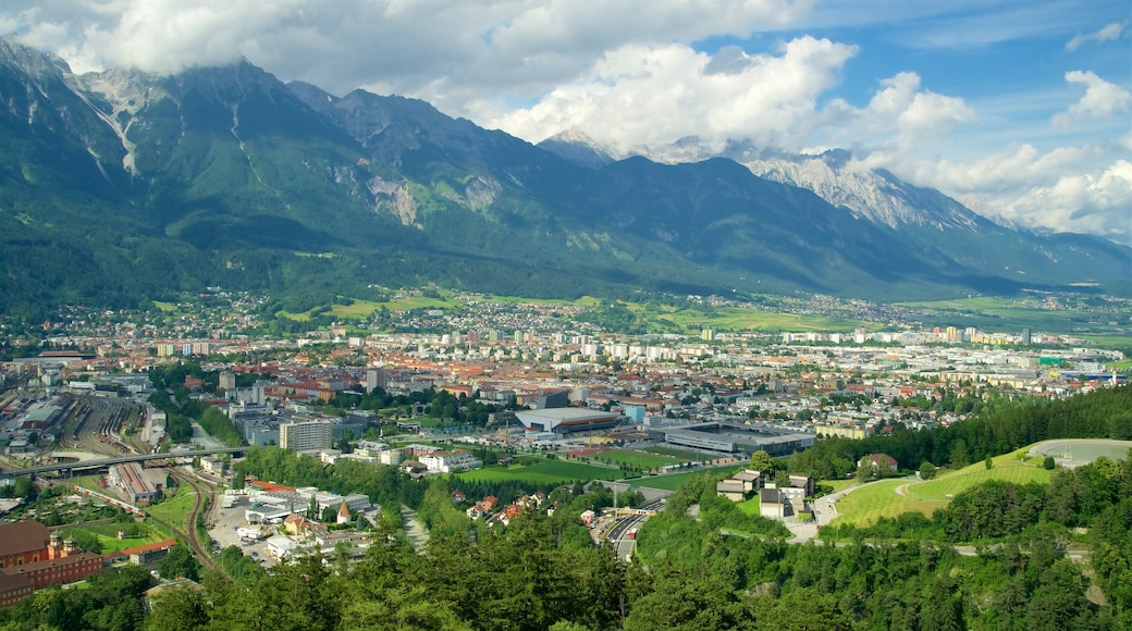 Bergisel Ski Jump showing a city, tranquil scenes and mountains