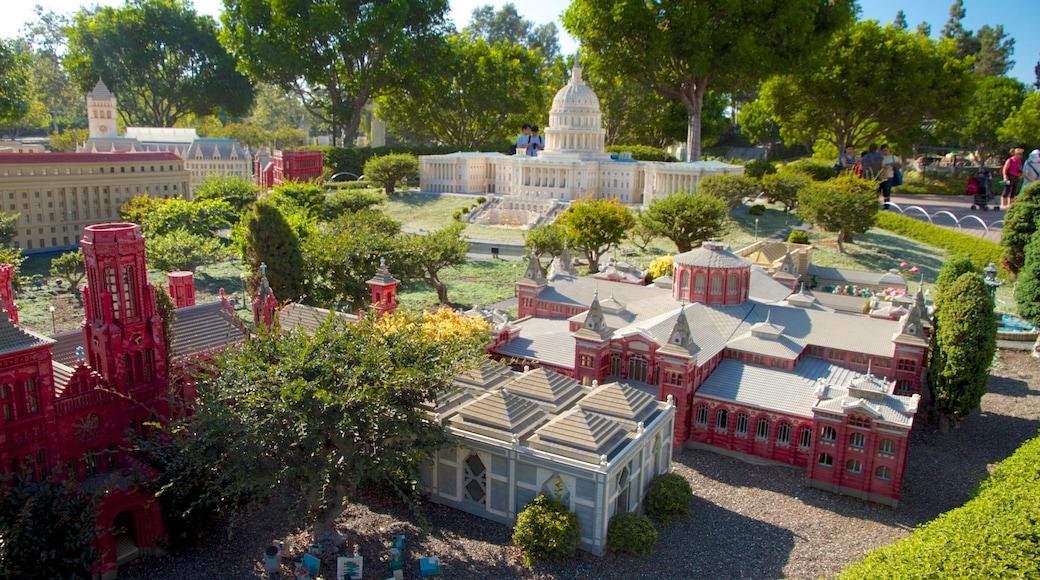 Legoland California showing rides and a garden