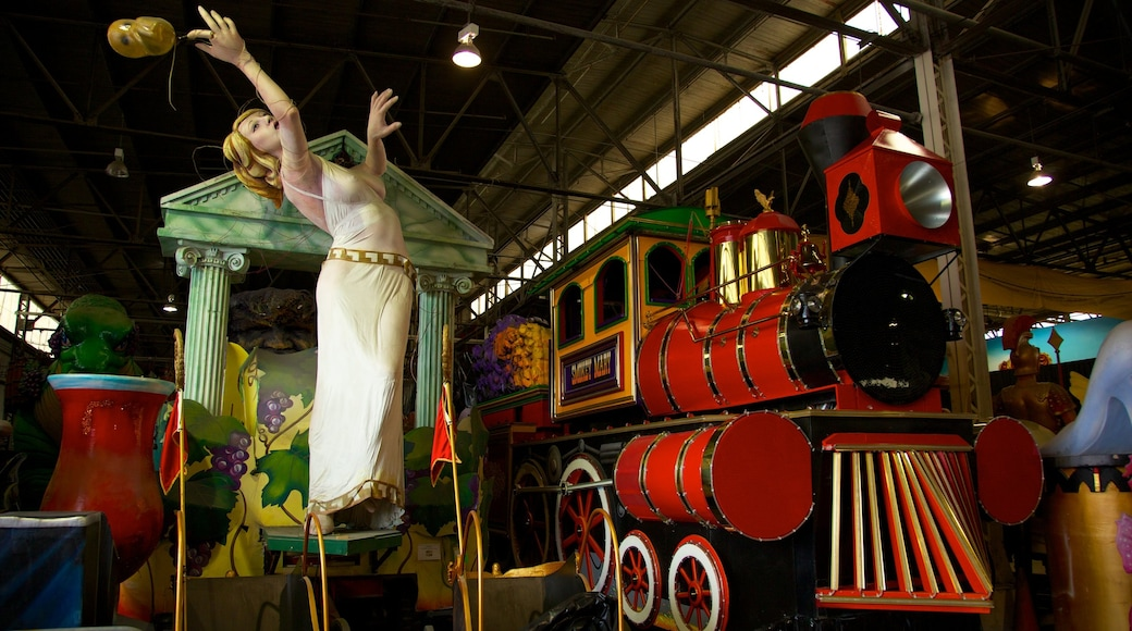 Mardi Gras World featuring railway items, rides and interior views