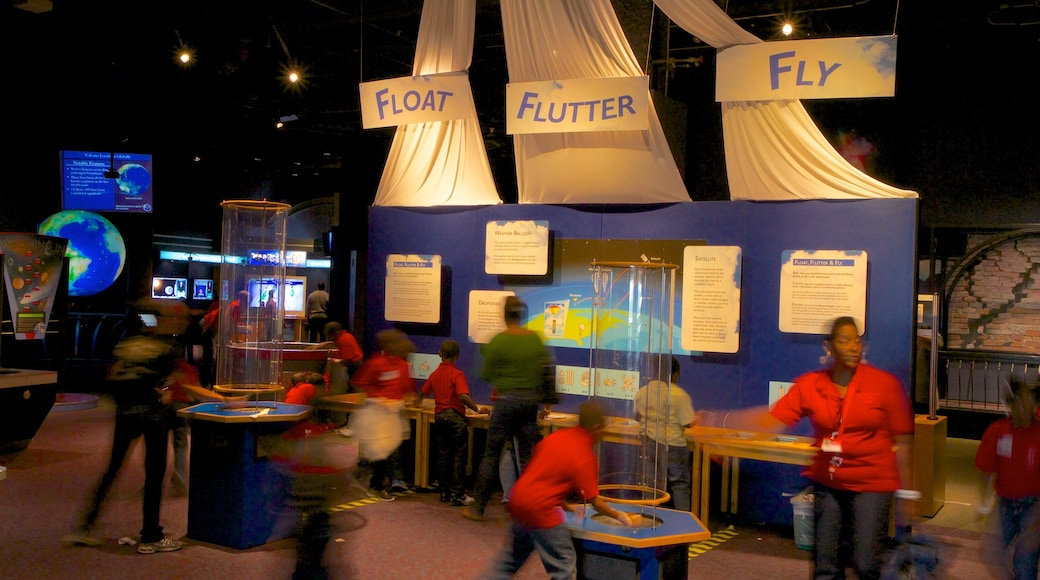 Orlando Science Center featuring interior views as well as a small group of people