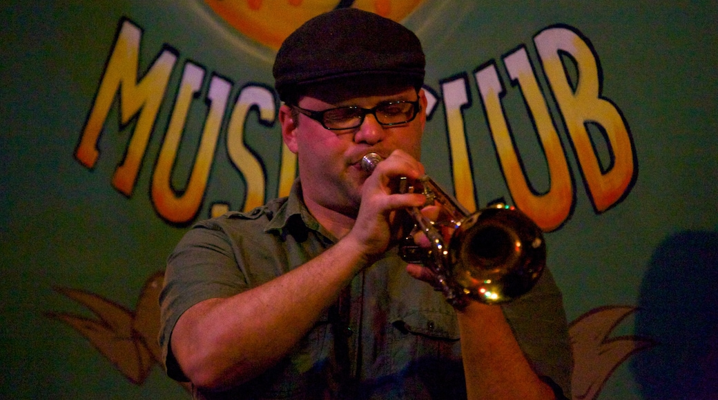 Frenchmen Street Jazz Clubs which includes music and performance art as well as an individual male