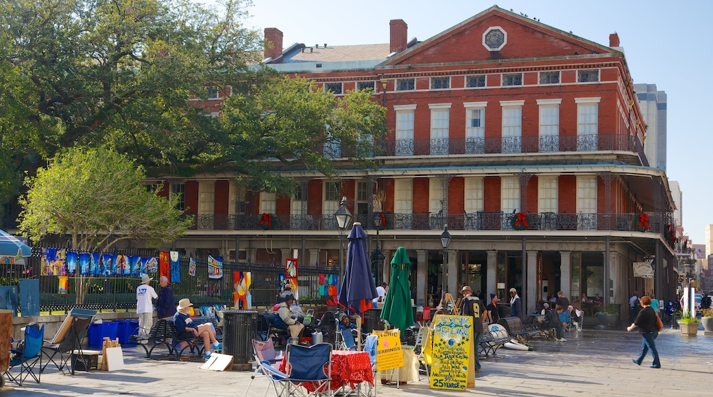 Jackson Square featuring a city and a square or plaza as well as a large group of people