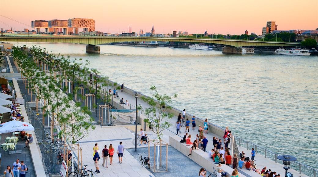 Cologne et environs qui includes pont, coucher de soleil et rivière ou ruisseau