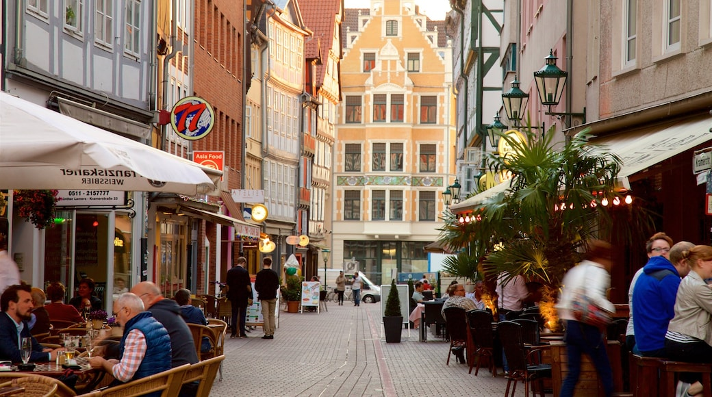 Hannover featuring outdoor eating as well as a small group of people
