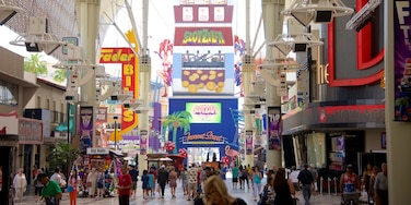 Downtown Las Vegas which includes signage as well as a small group of people