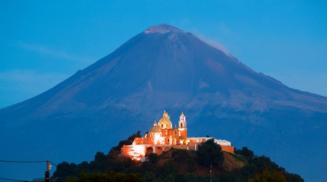 La Virgen de los Remedios Sanctuary showing heritage elements and mountains