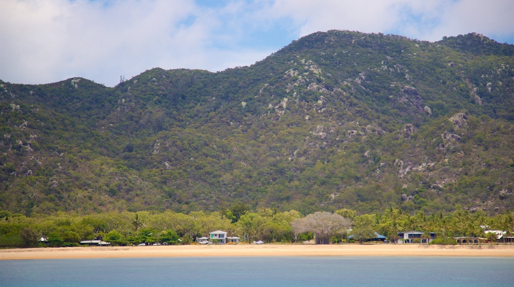 Magnetic Island which includes general coastal views, a beach and tranquil scenes
