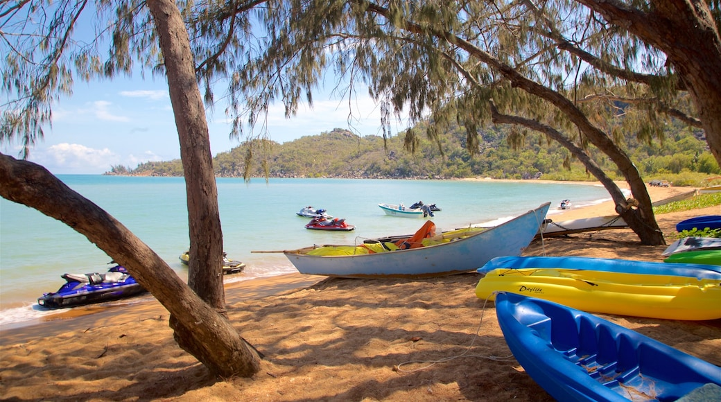 Magnetic Island showing a sandy beach, general coastal views and jet skiing