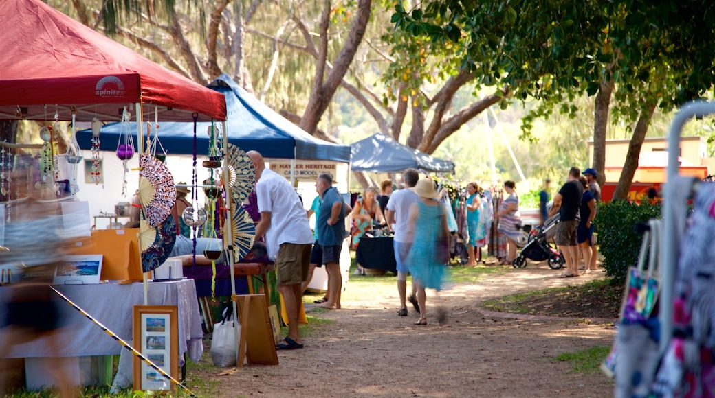Horseshoe Bay Beach which includes markets as well as a small group of people