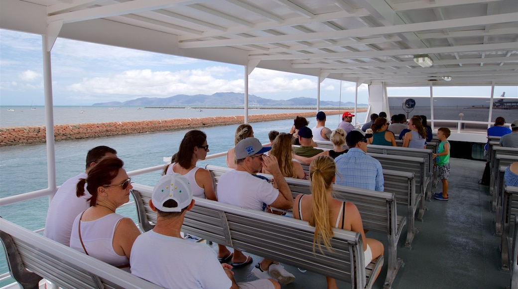 Magnetic Island Ferry Terminal showing a ferry as well as a small group of people