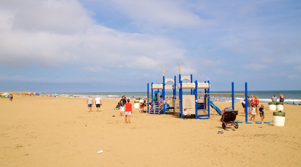 Neptune\'s Park which includes general coastal views and a beach as well as a small group of people