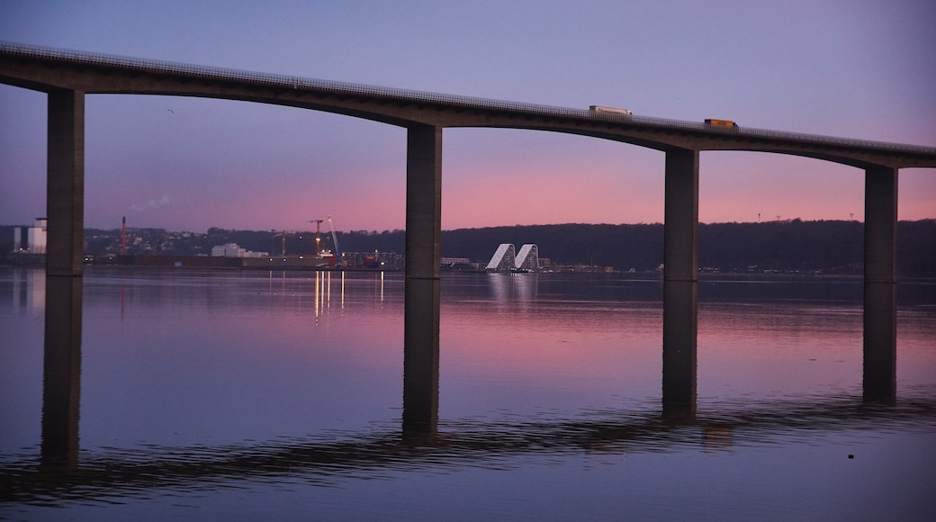 Vejle which includes a bridge, a river or creek and a sunset