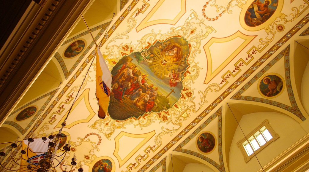 Saint Louis Cathedral featuring interior views, religious aspects and a church or cathedral