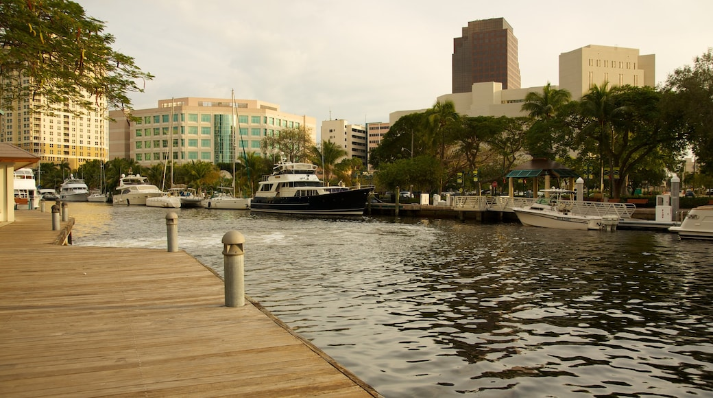 Riverwalk which includes a marina, a river or creek and landscape views