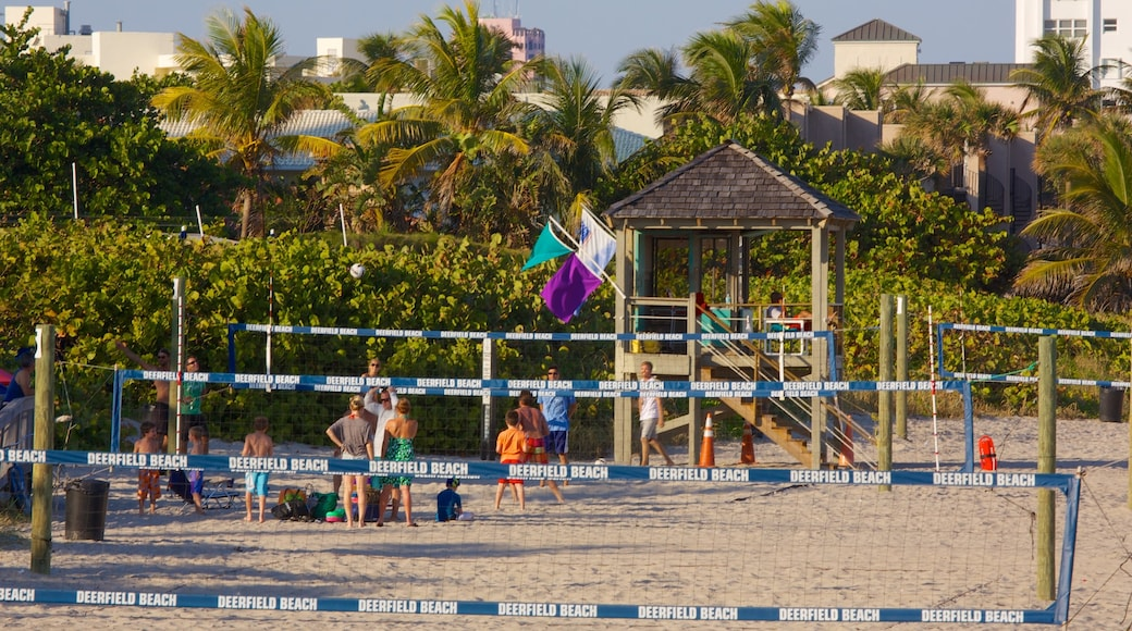 Deerfield Beach Pier which includes landscape views, a sandy beach and tropical scenes