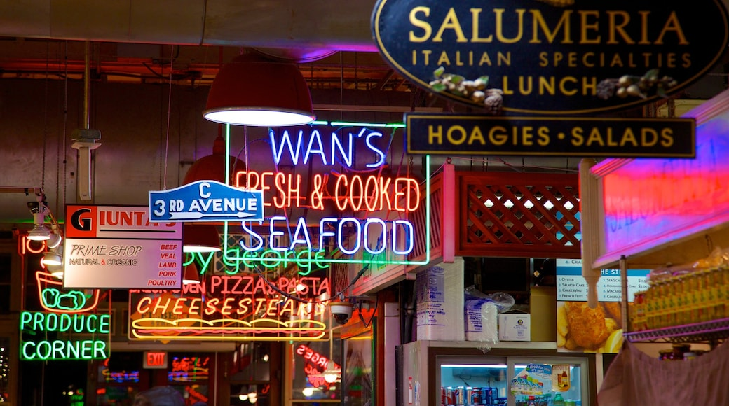 Reading Terminal Market which includes night scenes, dining out and a city