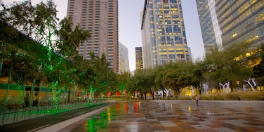 Discovery Green which includes a high-rise building, a square or plaza and a city