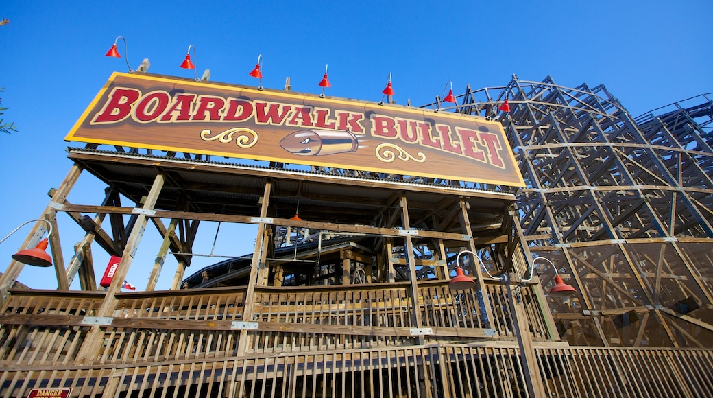 Kemah Boardwalk featuring rides and signage