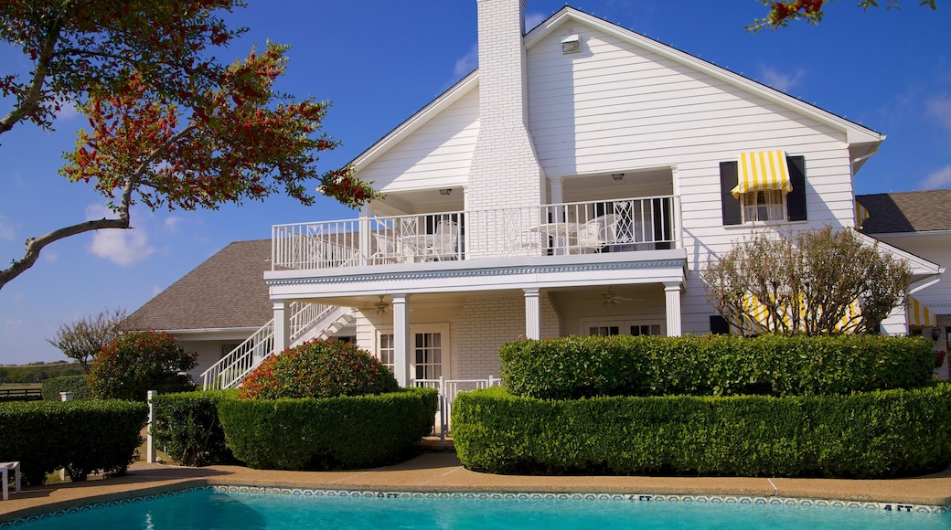 Southfork Ranch which includes a house and a pool