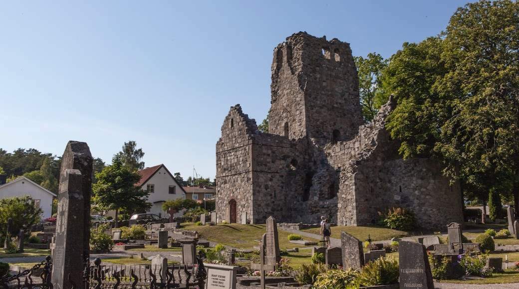 Sigtuna which includes heritage architecture and a cemetery