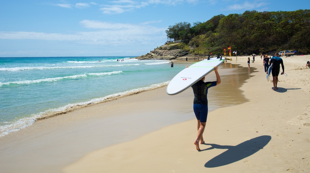 North Stradbroke Island which includes waves, general coastal views and a beach