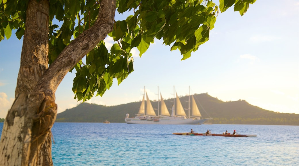 Vaitape featuring kayaking or canoeing, general coastal views and a sunset