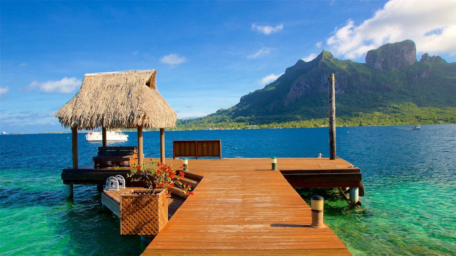 Bora Bora which includes tropical scenes, mountains and general coastal views