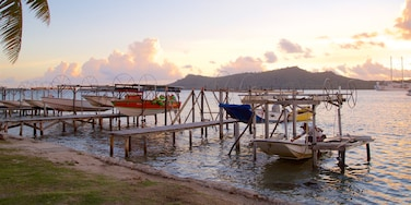 Vaitape featuring a sunset and a bay or harbour