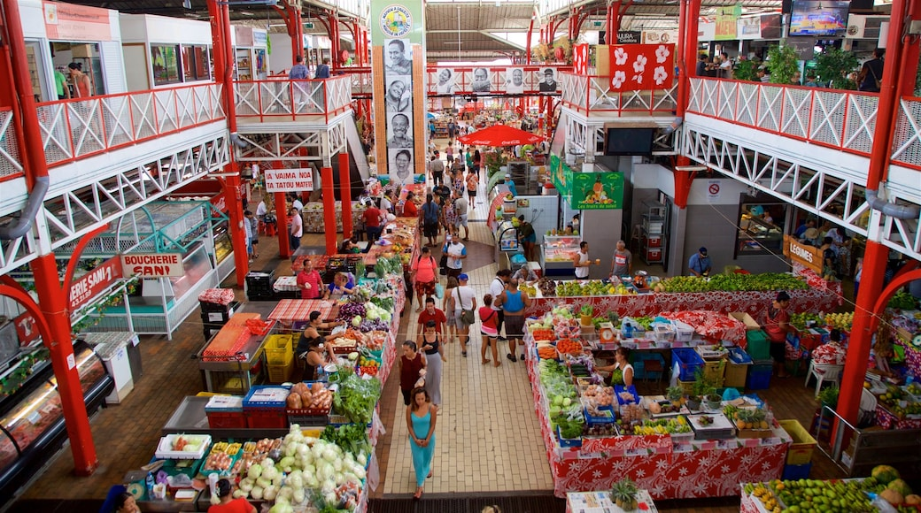 Papeete Market showing interior views and markets as well as a small group of people
