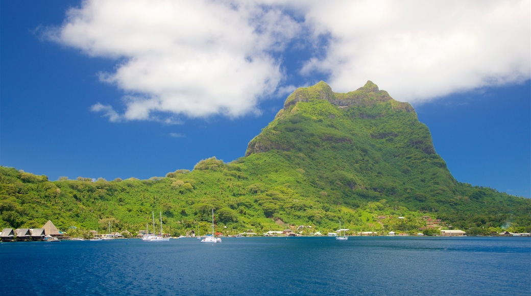 Mt. Otemanu showing mountains, general coastal views and a bay or harbour