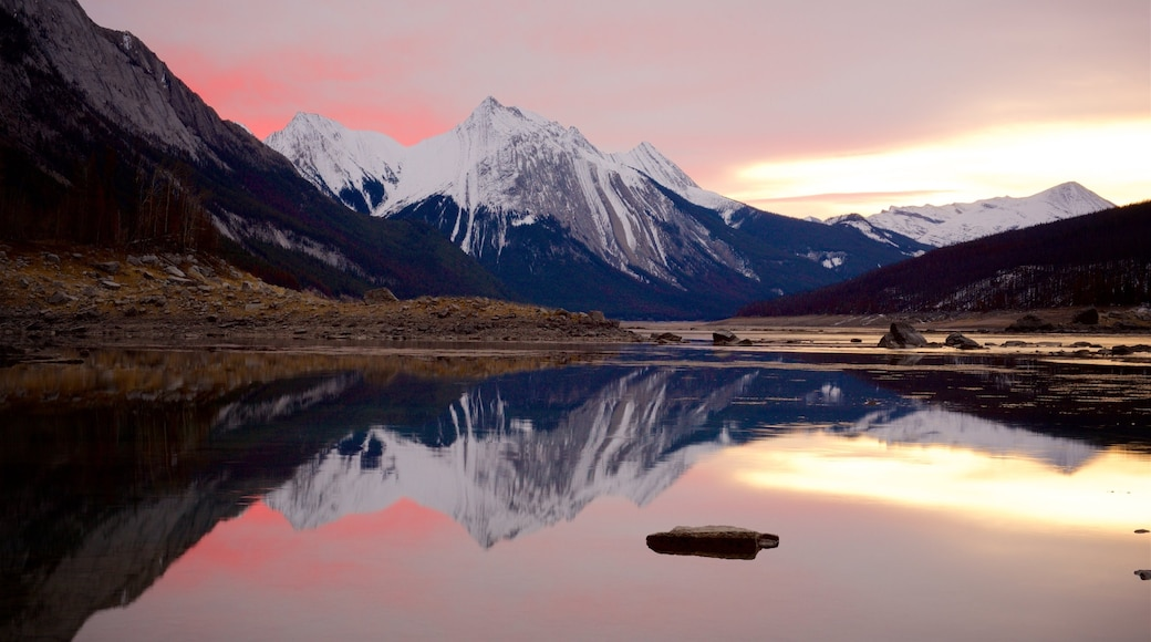 Medicine Lake featuring a lake or waterhole, a sunset and tranquil scenes