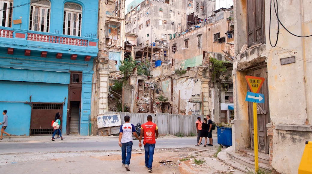 Old Havana showing building ruins as well as a small group of people
