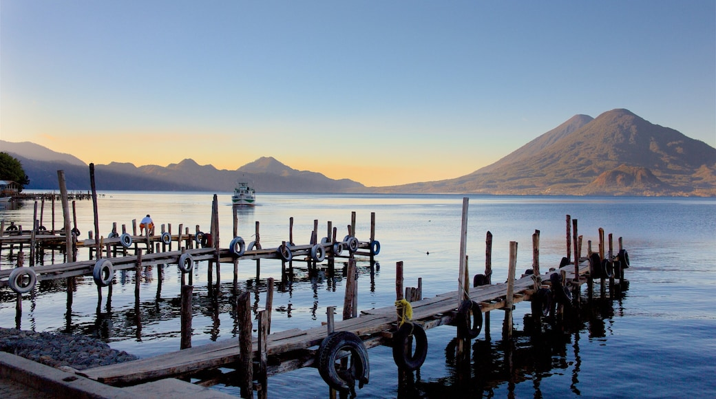 Guatemala featuring a sunset, mountains and a lake or waterhole