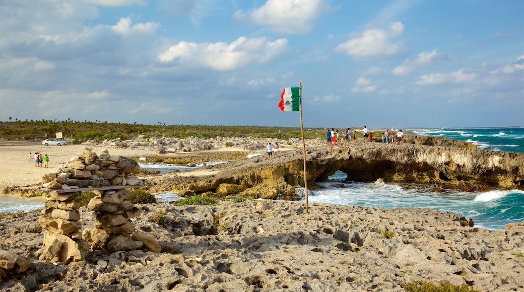 El Mirador showing general coastal views and rocky coastline as well as a small group of people