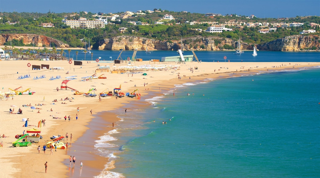 Rocha Beach featuring general coastal views and a beach as well as a large group of people