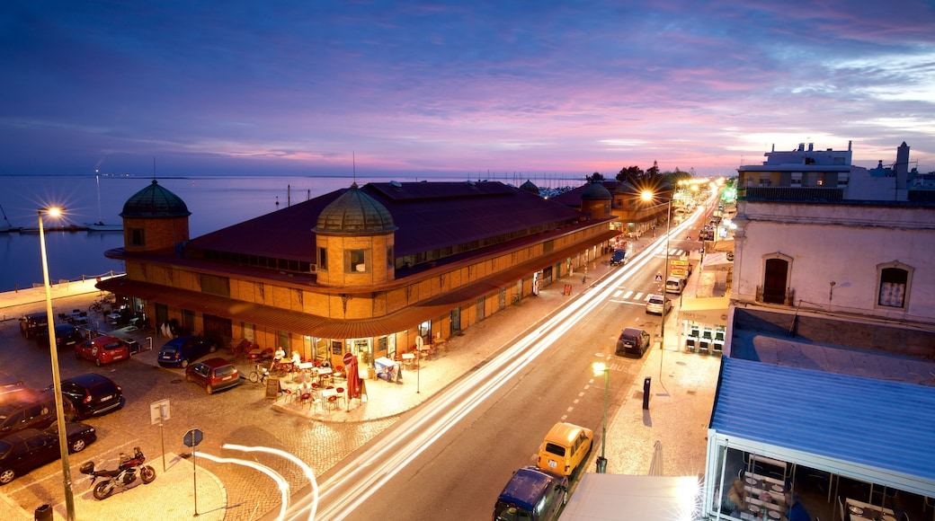 Olhao Municipal Market featuring a sunset and night scenes