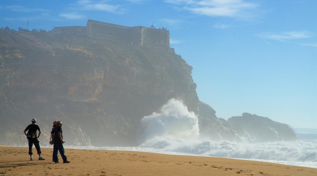 Norte Beach featuring rugged coastline, waves and a beach