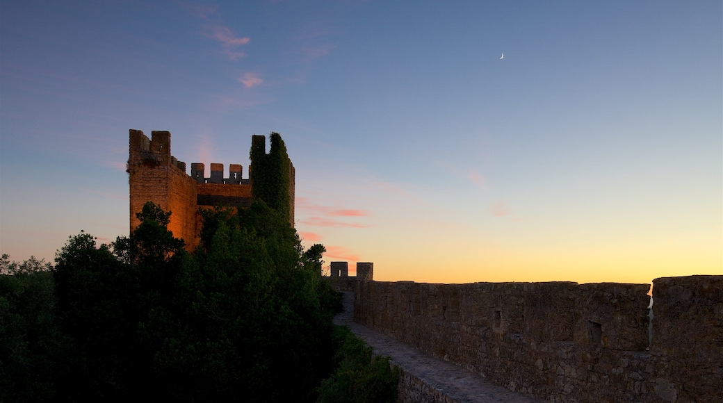 Obidos featuring heritage architecture and a sunset