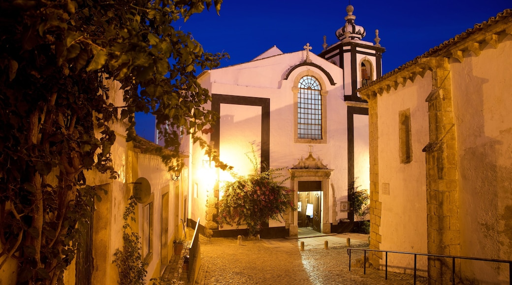 Obidos featuring night scenes and a church or cathedral