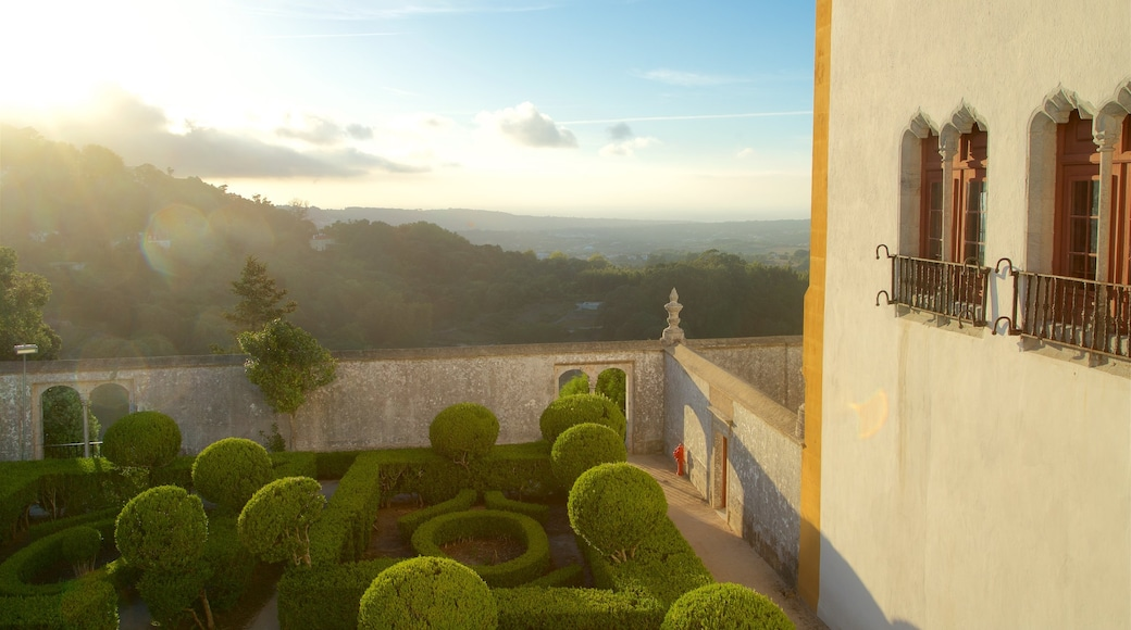 Sintra National Palace which includes a garden, a sunset and tranquil scenes