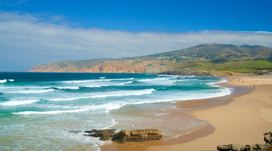 Guincho Beach which includes waves, a beach and tranquil scenes