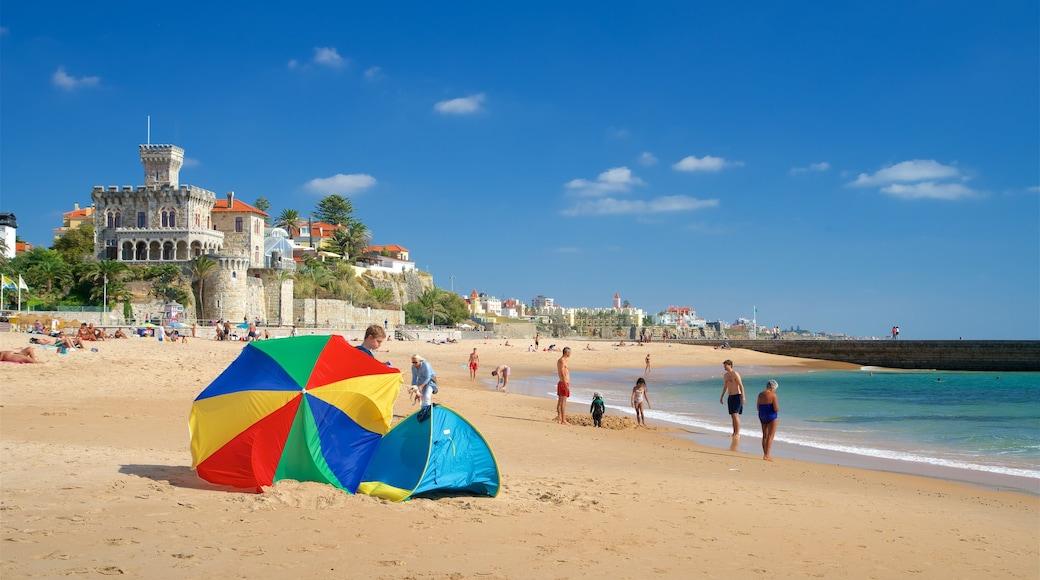 Spiaggia di Tamariz caratteristiche di vista della costa e spiaggia sabbiosa cosi come un piccolo gruppo di persone