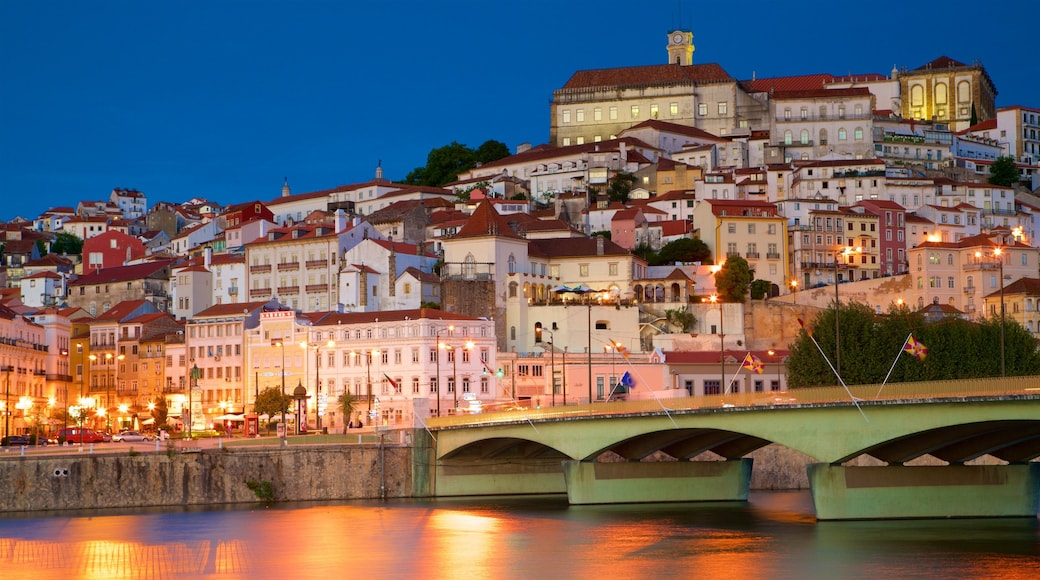 Coimbra showing a bridge, night scenes and a city