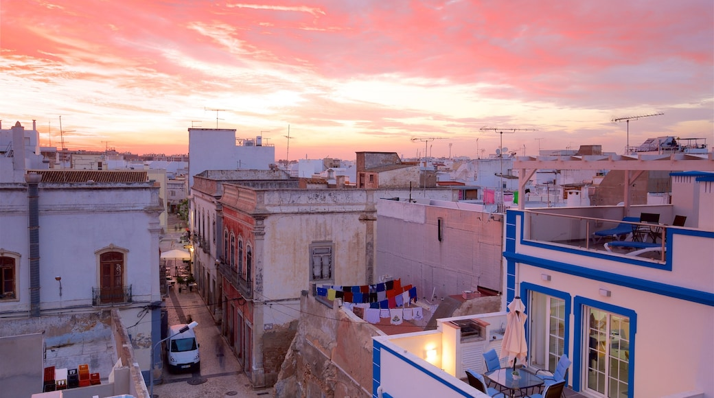 Olhao showing a city and a sunset