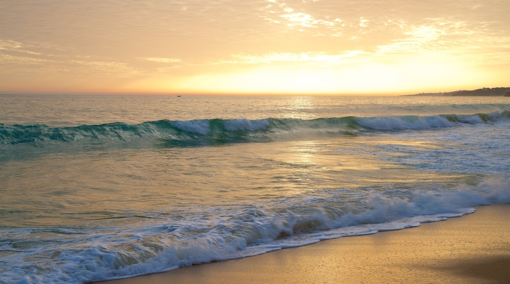 Falesia Beach which includes a sunset, a sandy beach and general coastal views