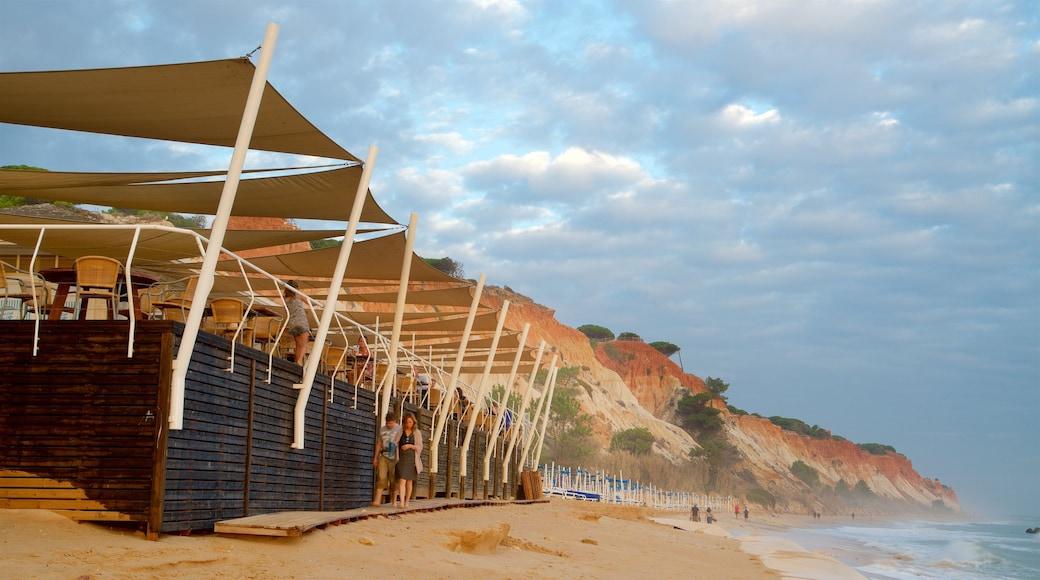 Falesia Beach which includes rugged coastline, a beach and general coastal views