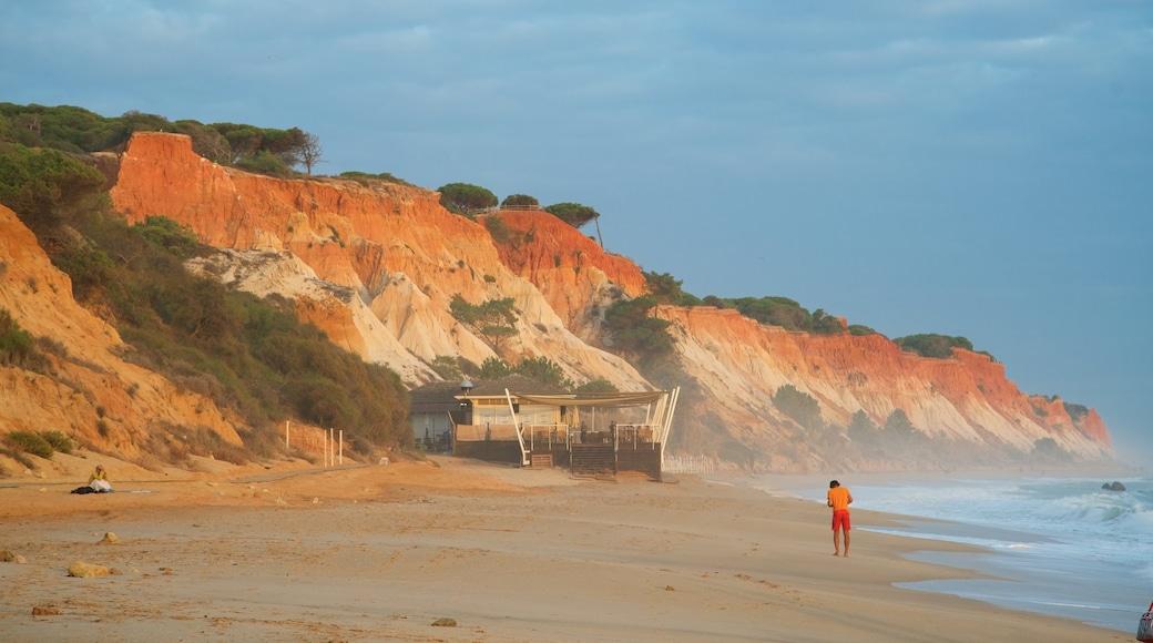 Falesia Beach showing a beach, rocky coastline and general coastal views