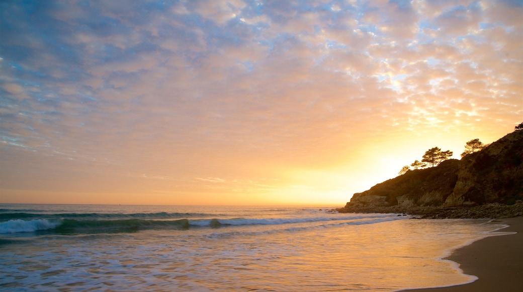 Falesia Beach featuring a sunset, rocky coastline and a beach