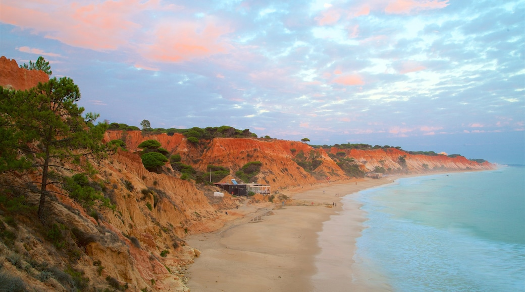 Falesia Beach showing a beach, a sunset and rocky coastline